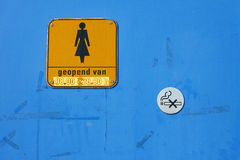 Door with WC sign. For women and no smoking button Royalty Free Stock Images