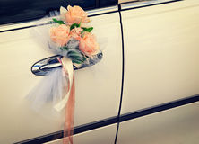 Door of  wedding car with flowers and white bow Stock Images