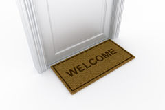 Door with welcome doormat Royalty Free Stock Images