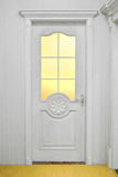 Door. A white door with bright light Royalty Free Stock Photography