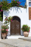 Door of white building in Lindos, Rhodos. Greece stock image
