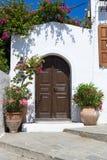 Door of white building in Lindos, Rhodos Stock Image