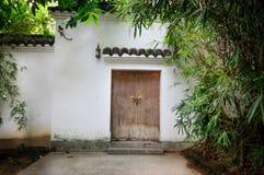 Door. A white fence around two door made of wood Stock Photo