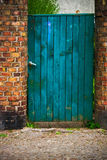 Door wicket gate wooden old wall brick red Royalty Free Stock Photo