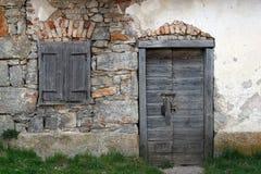 Door and window. Wood door and window, building facade Stock Photos