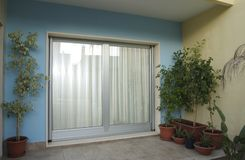 Door-window. Big door-window from outdoor view Stock Images