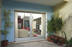 Door-window. A big door - window from outside view Stock Photo