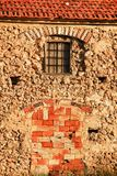 Door and window boarded up with bricks. Old door and window of a house boarded up with brick protection closed property abandoned shelter empty plaster wall royalty free stock images