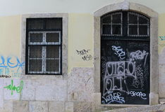 Door and window with graffiti. In Lisbon, Portugal Stock Images