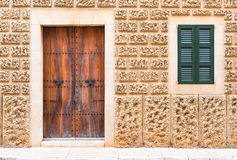 Door and Window of an Mediterranean House. Door and window on the facade of an mediterranean house stone wall Royalty Free Stock Photography