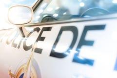 Door, window and side mirror of police car. Close-up of the left driver's door, window and side mirror of police car. There is inscription Police on door Stock Image