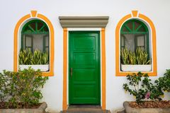 Door and windows decorated with painted color in Puerto De Mogan Stock Photos