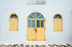 Door and windows. Old door and windows on the white building Royalty Free Stock Photo