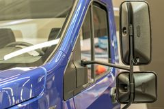 Free Door, Windshield And Hood With Reflections On It. Front Part Blue Cargo Vehicle Truck Body With Rear View Mirrors Close-up Stock Photos - 160207413