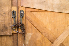 Door wood  lock with chains Royalty Free Stock Image
