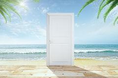 Door with wooden floor to a heaven with a beach and ocean Stock Image