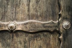 Door wooden old plank background and exterior detail of metal. stock photos
