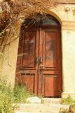 Door. A wooden door in one of the narrow streets of the old town of Rhodes, Greece Royalty Free Stock Images