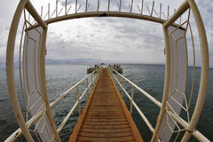 Door on wooden pier Stock Image