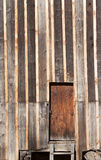 Door in a wooden wall - RAW format Stock Image