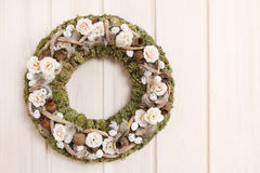 Door wreath with moss and artificial flowers Stock Image
