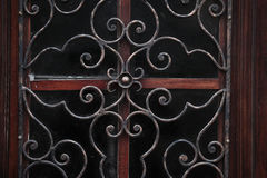 Door with wrought iron grating Royalty Free Stock Images