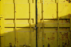 Door of yellow cargo container box background. Horizontal Shot. Royalty Free Stock Images