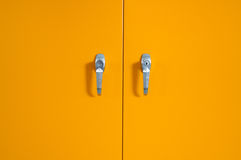Door. Yellow  Door of steel cupboard Royalty Free Stock Photos