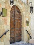 Door 3. Yellow stone enhances the brown finish of the door Stock Photos