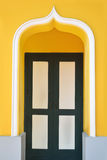 Door with yellow wall Stock Photography