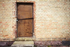 Door in a yellow wall Royalty Free Stock Photo