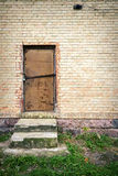 Door in a yellow wall Royalty Free Stock Photos
