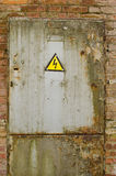 Door with yellow warning sign of danger Royalty Free Stock Photos