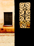 Door Yours Window On The World. The picture taken from inside a dark staircase showing one wing of exterior door, the street and the window on a wall opposite Stock Images