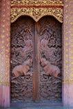 Door01. Wood carving Thai temple door Royalty Free Stock Image