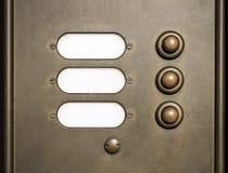 Doorbell. Brass door bell with three buttons stock photo