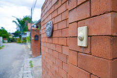Doorbell on the brick wall of Stock Image