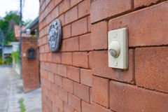 Doorbell on the brick wall of Royalty Free Stock Photography