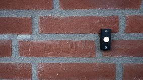 Doorbell button on a stone exterior wall Stock Images