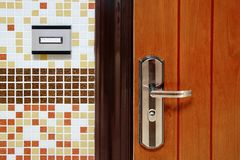 Doorbell Ring Button On The Wall And Metal Door Fragment Stock Photography