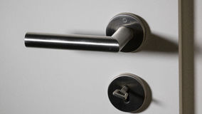 Doorhandle with key inside lock Royalty Free Stock Photos