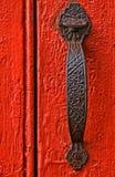 Doorhandle on red door Royalty Free Stock Image