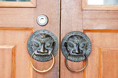 Doorknob. In classical door in China, it is made with brass Stock Photos
