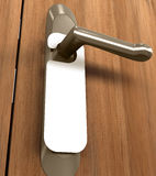 Doorknob. You can put your text on the white card Royalty Free Stock Photography
