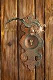Doorknob. On wood dor Stock Images