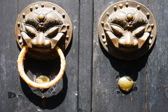 Doorknob. Asian Doorknob at a wooden door in shanghai Stock Photo