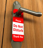 Doorknob / Do Not Disturb. Doorknob with a notice.  Concept of Hotel and Rest Stock Photos