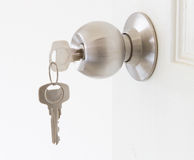 Doorknob with the key. Metal doorknob with the key Stock Photo