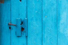 The doorknob on the old board shed. The doorknob on the old blue board shed royalty free stock images