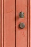 Doorknob. Retro doorknob on red door Royalty Free Stock Photography